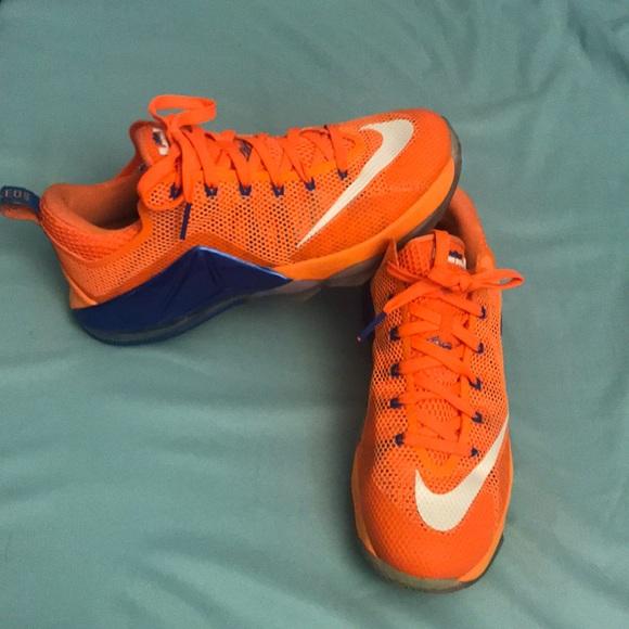 2507e86ab992 Men s Nike LeBron 12 Low Bright Citrus Shoes. M 5b94a3304ab6331d8e884a6c